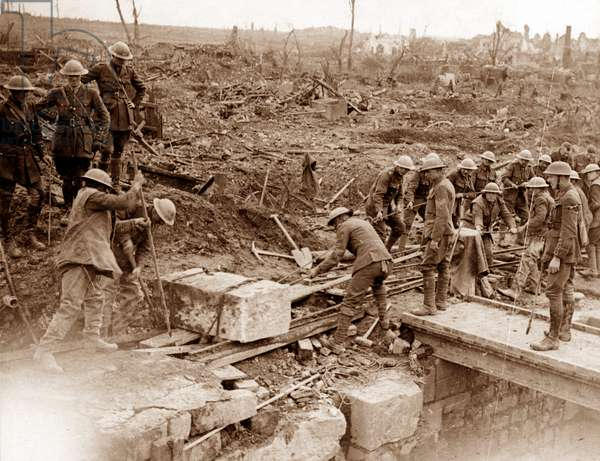 Royal Engineers repairing a bridge on the Western Front, 1918 (b/w photo)