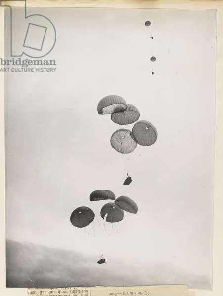Parachute drop (b/w photo)