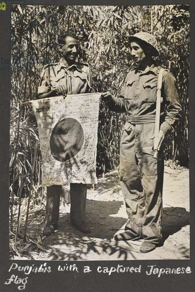Punjabis with a captured Japanese flag, Arakan, 1944-45 (b/w photo)