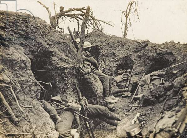 Soldiers of the Border Regiment resting in a front line trench, Thiepval Wood, August 1916 (b/w photo)