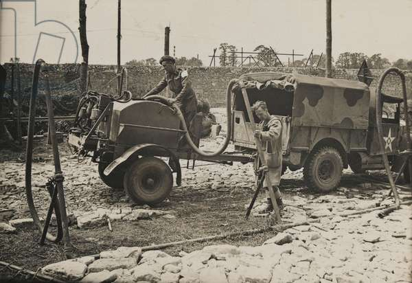 Water carriers to the British Army in Normandy, June 1944 (b/w photo)