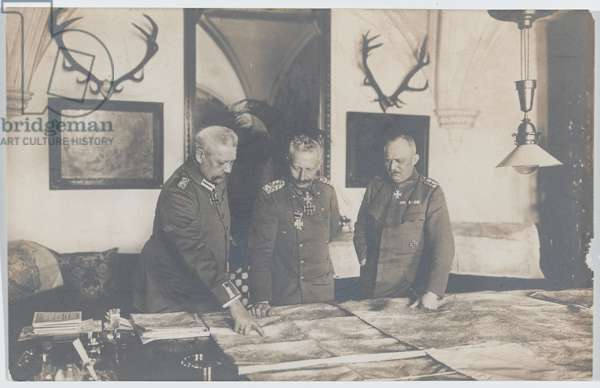 The Kaiser studying maps with Field Marshal Paul von Hindenburg and General Eric Ludendorff, 1917 (b/w photo)
