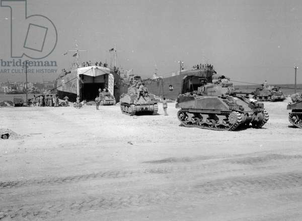 British tanks load onto Landing Ship Tank (LST) prior to the Allied invasion of Italy in September 1943 (b/w photo)