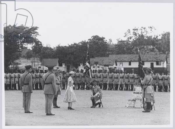 the presentation of colours by HM Queen Elizabeth II to 4th King's African Rifles, April 1954 (b/w photo)