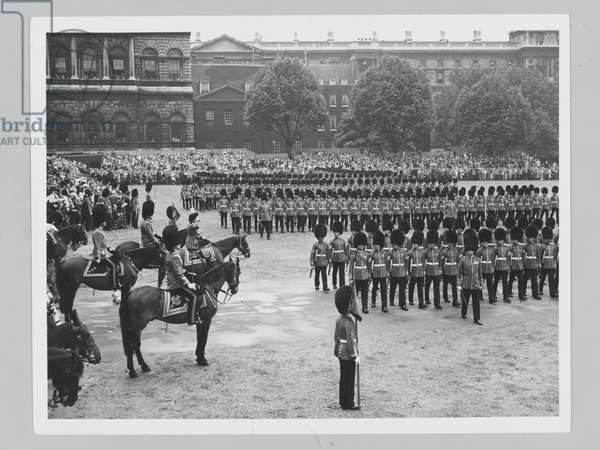 H.M. The Queen, in the scarlet of the Grenadiers and wearing a black tricorn hat with a white plume took the salute at the Trooping of the Colour Ceremony, the Queen's Official Birthday, on Horse Guards Parade, 11 June 1960 (b/w photo)
