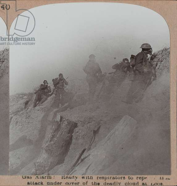 'Gas Alarm! Ready with respirators to repel a Hun attack under cover of the deadly cloud at Loos', 1917 circa (b/w photo)