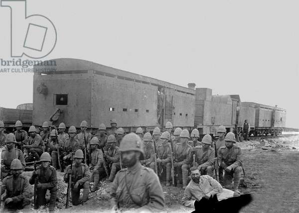 Troops in front of an armoured train, 1900 circa (b/w photo)