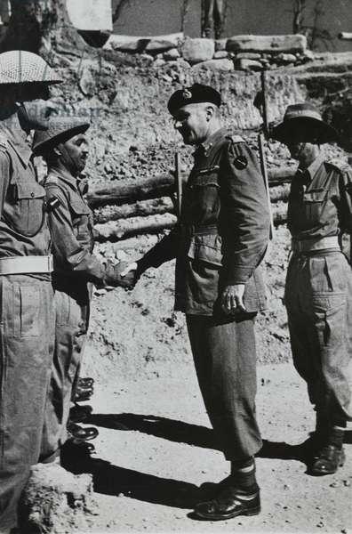Major General Frank Messervy congratulating Jemadar Ramji Lal MC, 1946 (b/w photo)