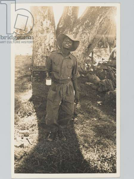 A soldier of the King's African Rifles at a rest camp in Assam, 1944  (b/w photo)