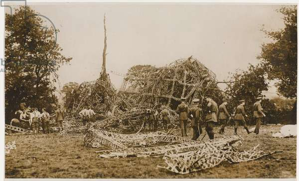 The wreckage of a Zeppelin being inspected by British soldiers,September 1916 (b/w photo)
