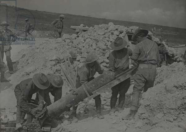Australian troops loading a 9.45 inch trench mortar on the Somme, August 1916 (b/w photo)