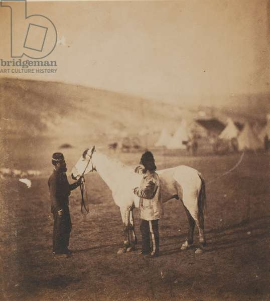 Captain Bernard, 5th (Princess Charlotte of Wales's) Dragoon Guards with his horse and an orderly, 1855 circa (b/w photo)