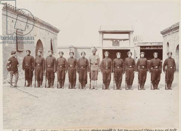 Soldiers of the 1st Chinese Regiment on parade, 1900 circa (b/w photo)