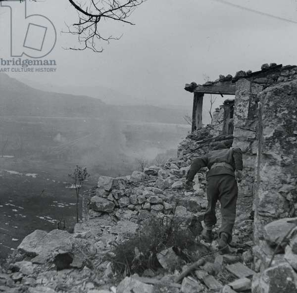 New Zealand infantry entering Cassino, taking cover in ruined houses, Italy, March 1944 (lantern slide)