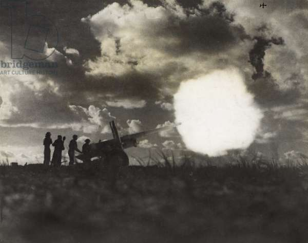 Allied forces firing a 4.5 inch gun near Tarhuna, during the time when the Eighth Army was advancing on Tripoli, Feb 1943 (b/w photo)
