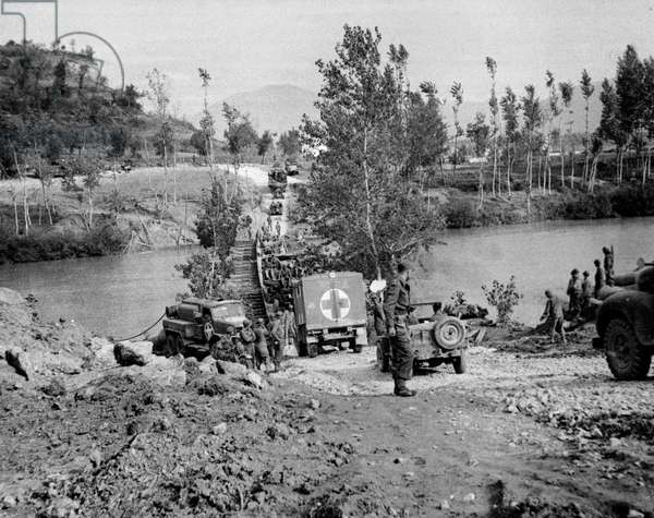 British and American transport and supplies crossing a pontoon bridge over the Volturno river, Italy, c.1943-45, from a collection of 650 photographs compiled by the Commando Association (b/w photo)