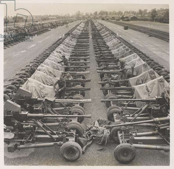 """40mm Bofors Light AA guns on Mark II mountings and """"Ducks"""" stockpiled in England prior to """"D"""" Day (b/w photo)"""