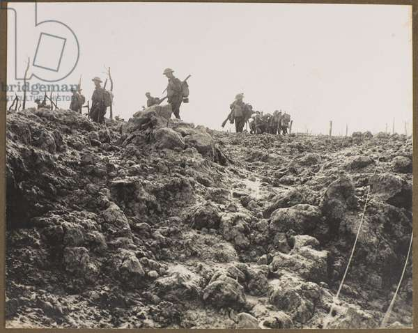 Soldiers advancing on Pilckem Ridge during the Third Battle of Ypres, 1917 (b/w photo)