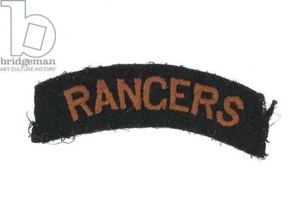 One of a pair of embroidered shoulder titles, associated with L/Cpl J R Dixon, 12th (County of London) Bn The London Regiment (The Rangers), c.1917 (textile)