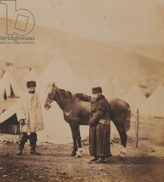 Colonel Low, 4th (The Queen's Own Light) Dragoons with his horse and an orderly, 1855 (b/w photo)