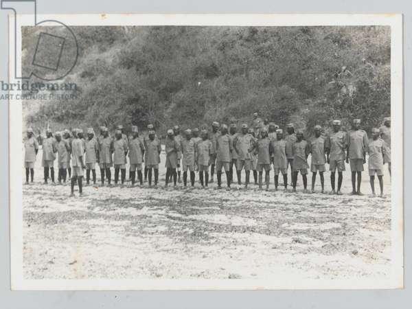 4th (Uganda) Battalion, King's African Rifles, parading on a beach, Mombassa, Kenya, 1939 (b/w photo)