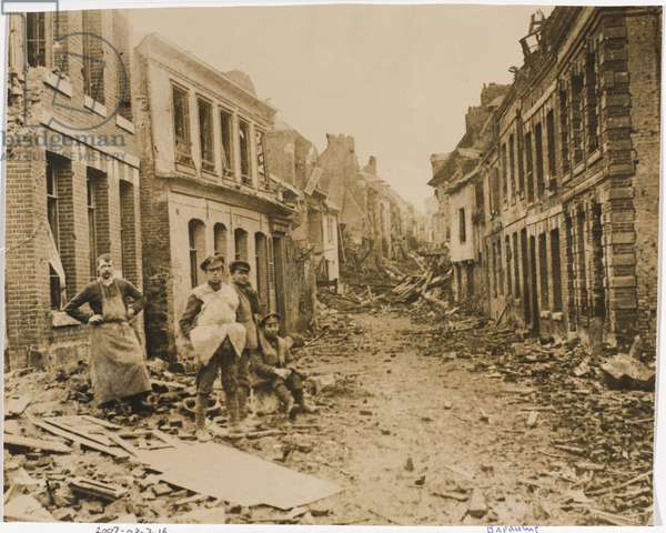 British soldiers in a war-damaged street in Bapaume, 1918 (b/w photo)
