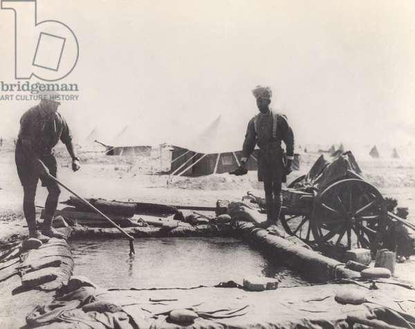 Chlorinating water at a desert reservoir, 1916 circa (b/w photo)