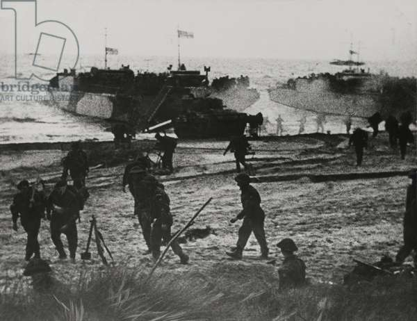 Landing craft and soldiers coming ashore at Ouistreham or Bernieres, St Aubin sector, 6th June 1944 (b/w photo)