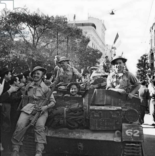 Allied troops being welcomed as they pass through the town of Tunis, May 1943 (b/w photo)