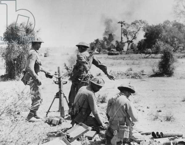 Indian soldiers of a mortar platoon in action supporting advancing tanks, from an official collection of photos from the Middle and Far East during World War Two compiled by Major General Messervy (b/w photo)