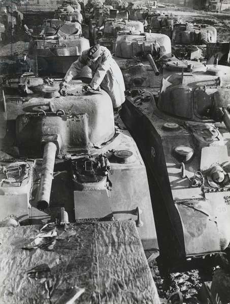 U.S. Supply Depot in England Prepare for Invasion: An American officer giving the 'once over' to a newly arrived tank from the U.S. (b/w photo)