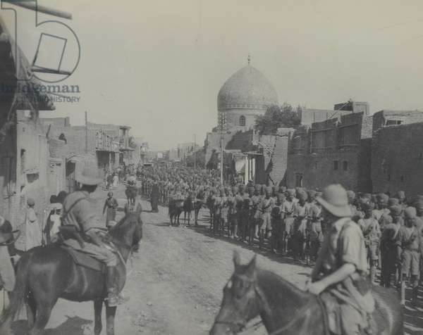 Indian troops marching through New Street, Baghdad, 1917 (b/w photo)