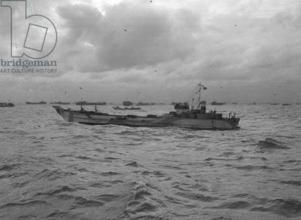 'An LCT, part of the convoy, passing through other shipping assembling in the Solent', June 1944 (b/w photo)