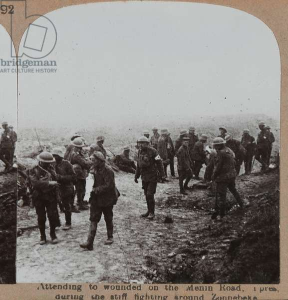 'Attending to wounded on the Menin Road, Ypres, during the stiff fighting around Zennebeke', 1917 (b/w photo)