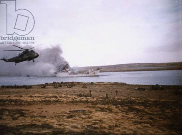 One of four colour photographs showing RFA Sir Galahad on fire after being bombed at Fitzroy, 7-8 June 1982 (photo)