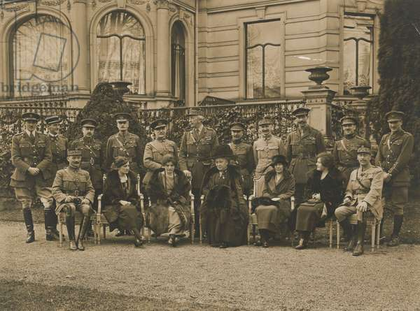 Photograph of a group, General Staff including Princess Beatrice, Marshal Foch and Sir Henry Wilson, wearing each other's hats, Cologne, 1919 (b/w photo)