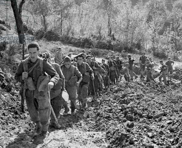 Grenadier Guards climbing a steep road to their forward positions, c.1943-45, from a collection of 650 photographs compiled by the Commando Association (b/w photo)