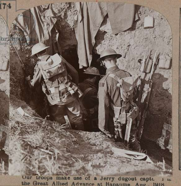 'Our troops make use of a Jerry dugout captured by the Great Allied Advance at Bapaume', August 1918 (b/w photo)