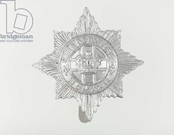 Cap badge, c.1964 (metal)
