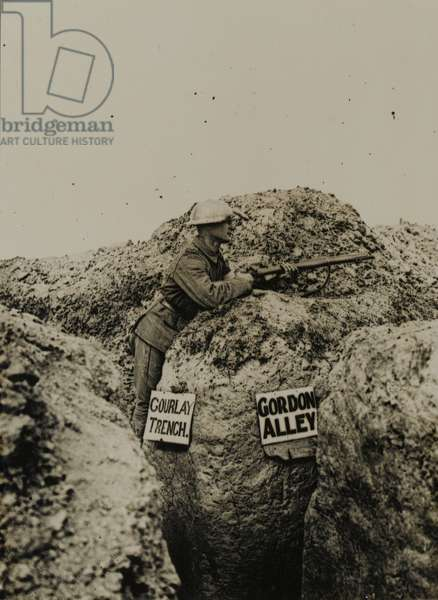 Soldier with rifle in trench, 1917 circa (b/w photo)