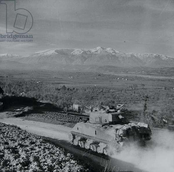 Sherman tanks moving down to the Sangro River, Italy, November 1943 (lantern slide)