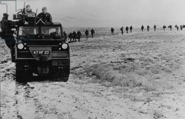 Volvo 202 Oversnow vehicle with a column of commandos trailing behind on foot, Falklands, 1982 (b/w photo)
