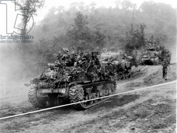 Tanks moving through the tank runs, from an album containing 211 photographs compiled by Major W.H.J. Sale, 1944-45 (b/w photo)
