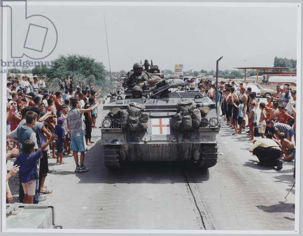 The KFOR invasion passing Stenkovich refugee camp, just inside Macedonia, before crossing into Kosovo, 1999 (photo)