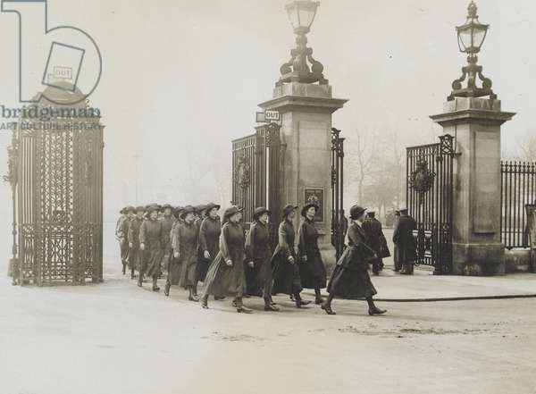 Women's Army Auxiliary Corps marching through iron gates, 1917-18 (b/w photo)