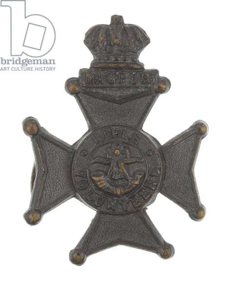Collar badge, Nagpur Volunteer Rifles, pre-1904 (metal)