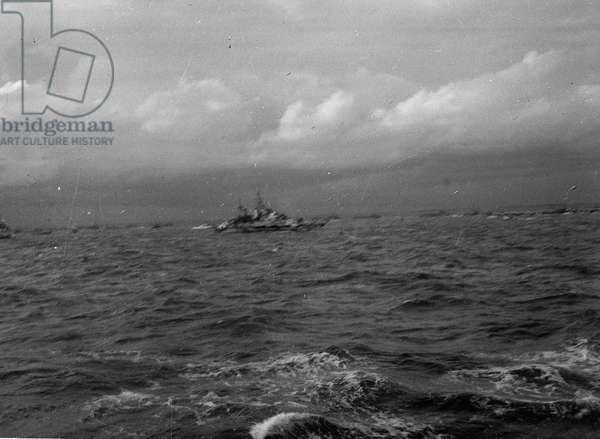 'A light cruiser off the beaches, 7th June, 1944' (b/w photo)