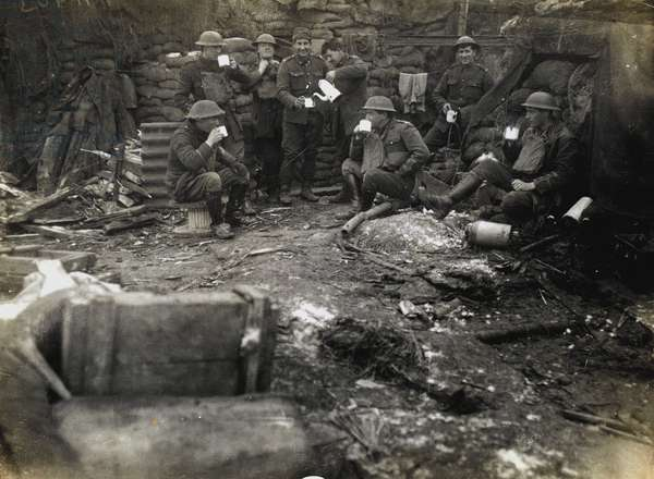 British officers and men enjoy a cup of tea in their trench, 1918 (b/w photo)