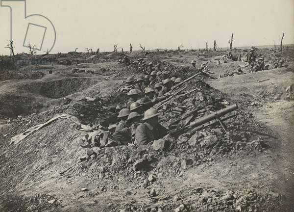 British soldiers man a line of shell craters, 1917 circa (b/w photo)