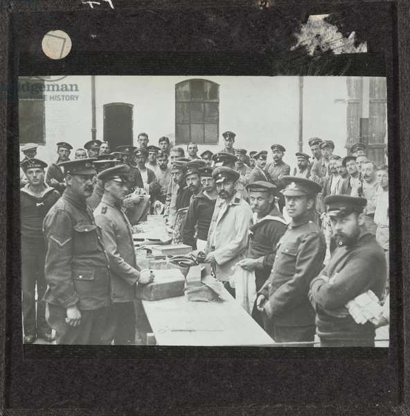 German prisoners receiving parcels from Germany at Handforth Camp in Cheshire, 1917 (lantern slide)